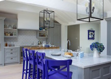 Neutral kitchen with royal purple bar stools
