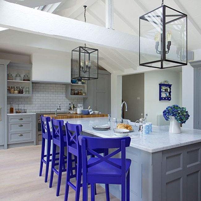 View In Gallery Neutral Kitchen With Royal Purple Bar Stools