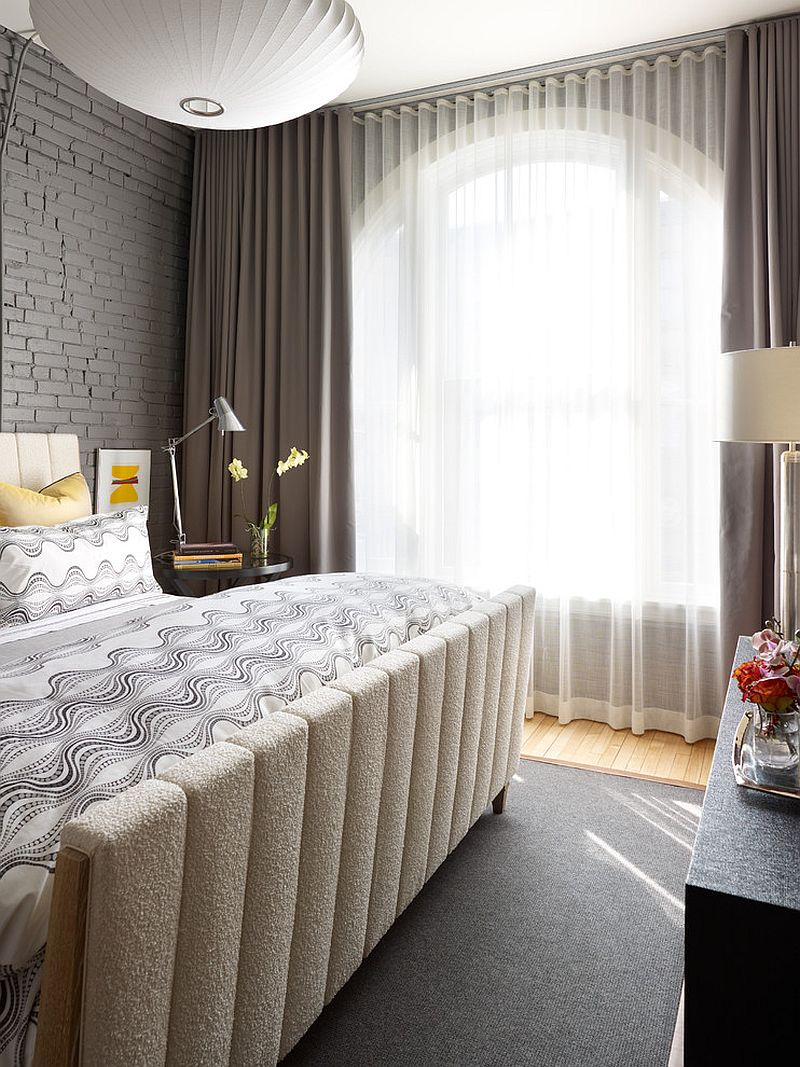 Nothing like a gray brick wall in the bedroom for refined coziness! [Design: Tom Stringer Design Partners]
