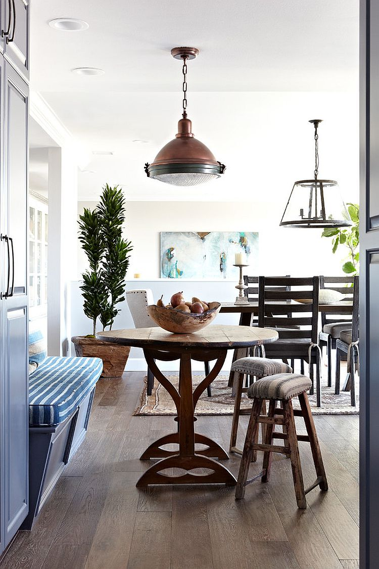 Oak flooring and simple dining room decor create a relaxing ambiance [Design: Janette Mallory Interior Design]