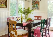 Old painted chairs and table give the dining room a classical element