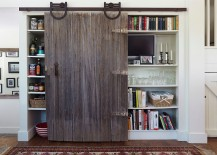 Old, reclaimed sliding barn door for the kitchen cabinet and pantry