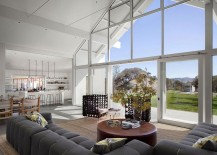 Open-living-area-of-the-lovely-home-with-a-rustic-backdrop-217x155
