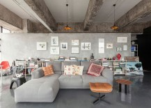 Open-plan-living-area-of-industrial-loft-with-plish-gray-couch-217x155