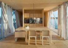 Open plan living area with dining space and kitchen inside the uber cool floating house 217x155 Floatwing: Modular, Prefabricated Houseboat Offers an Exciting Escape!