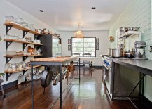 Open shelves and kitchen island provide ample storage space in this elegnat kitchen