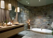 Opulent bathroom with a sunken Jacuzzi and a curved stone wall