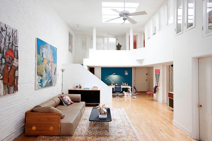 Original artwork and gorgeous decor fashion a contemporary, tasteful interior