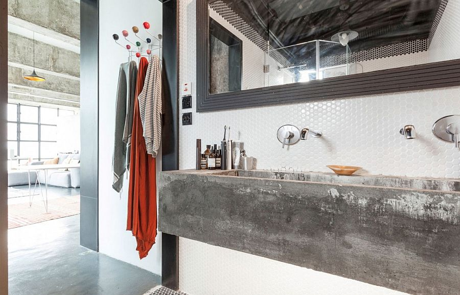 Penny tiled backsplash and concrete sink for the industrial bathroom