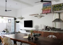Picture ledge, wall art and carefully-chosen accessories add color to the neutral kitchen and living space