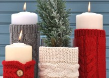 Pillar candles with knitted sweater sleeves