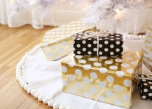 Polka dot gift wrapping paper in gold, black, and white