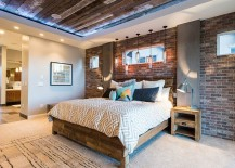 Reclaimed wood ceiling and exposed brick walls in the bedroom