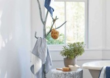 Recycled silver metal branch coat tree in bathroom