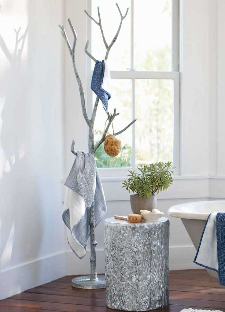 Silver metal branch coat tree in bathroom