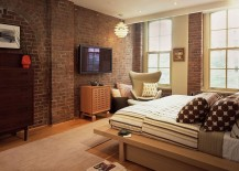 Red brick wall in the modern bedroom seems perfectly at home [Design: BarlisWedlick Architects, Tribeca Studio]