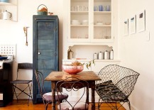 Repainted vintage cabinet, reclaimed decor and fabulous furniture shape the smart dining room