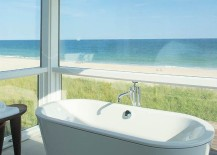Revamped beach-front home with a bathroom that opens towards the view outside