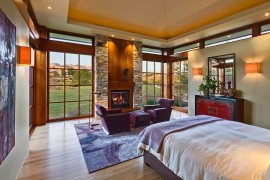 Rustic bedroom with modern touches and a cozy fireplace