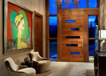 Rustic modern entry with unique door colorful artwork and a lovely chandelier 217x155 Rustic Modernity: Enthralling Vail Mountain Home Leaves You Awestruck!