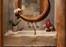 Rustic powder room with bespoke sandstone countertop and integral sink