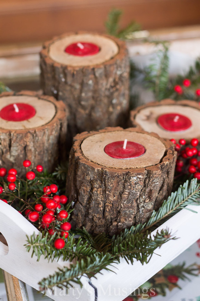 Rustic wood candle holders with red tea lights