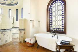 Saltillo tile in the bathroom brings warmth to the modern Mediterranean setting