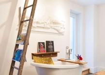 Salvaged wooden shelf, old ladder and vintage bathtub fashion an opulent and distinct bathroom