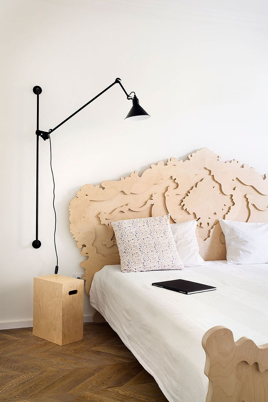 Sconce lighting fixture used as space-saving bedside light