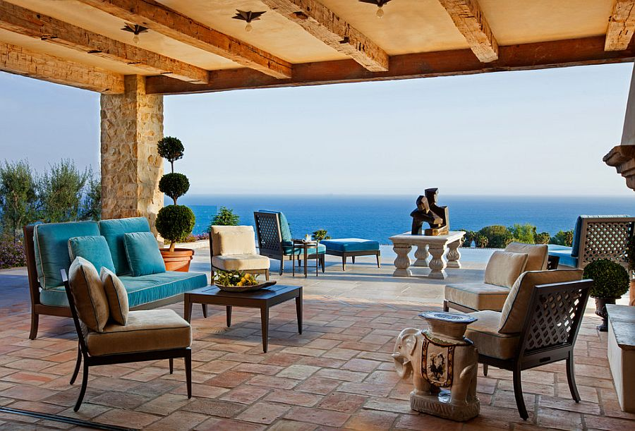 Shaded Mediterranean patio with pool area and ocean views