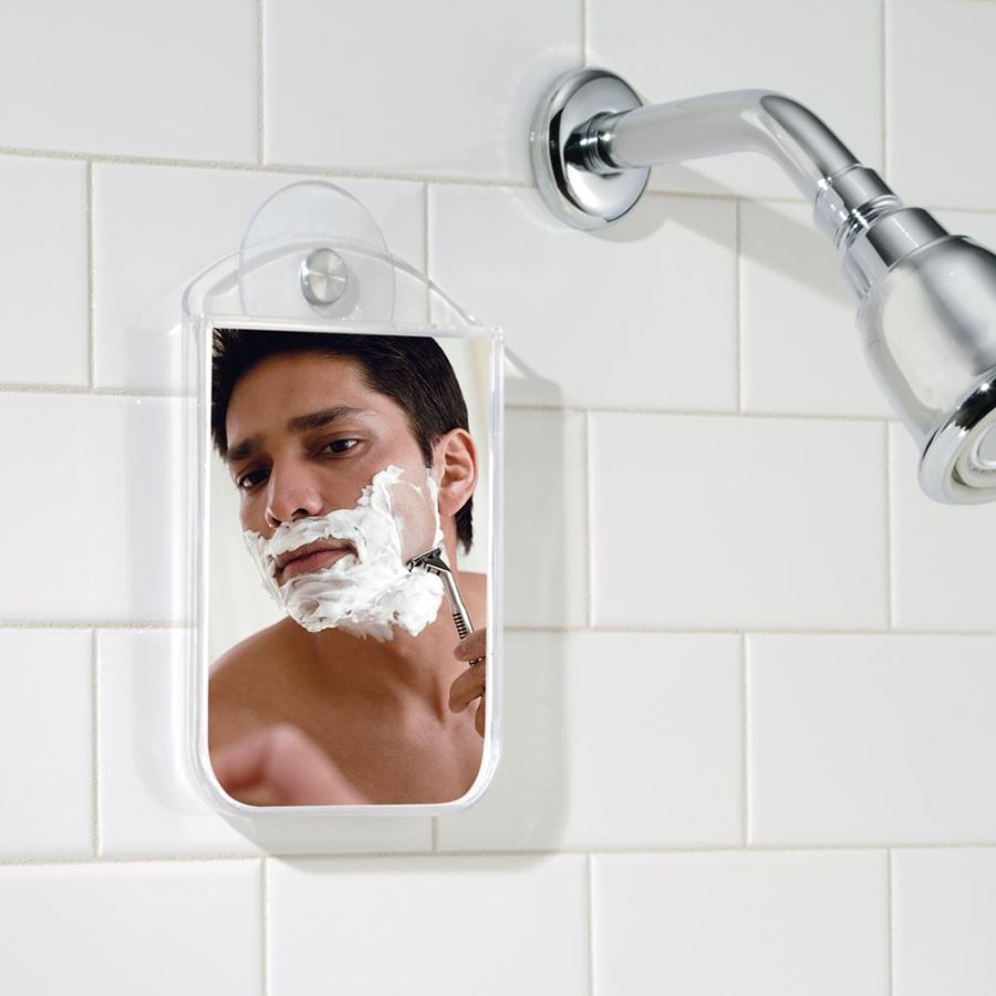 Shaving mirror with a suction cup