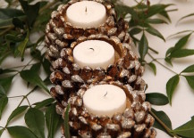 Shimmery pinecone candle holders with white tea lights 217x155 17 Easy DIY Holiday Candle Holders