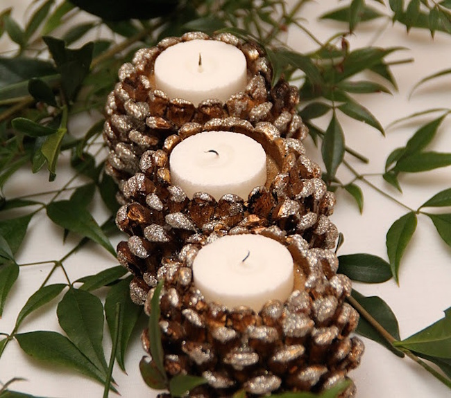 Glittery pinecone candle holders with white tea lights