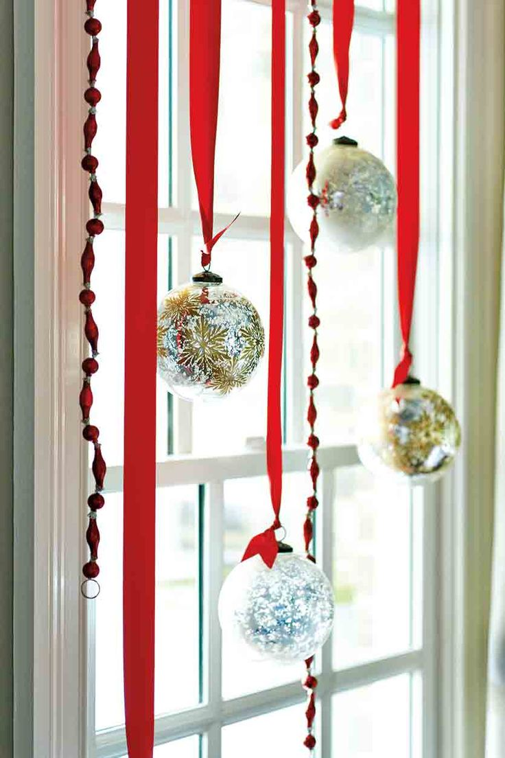 7 festive decorations to hang in your windows for the holidays for Hanging christmas decorations