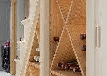 Simple wine storage idea for the small space under the modern staircase