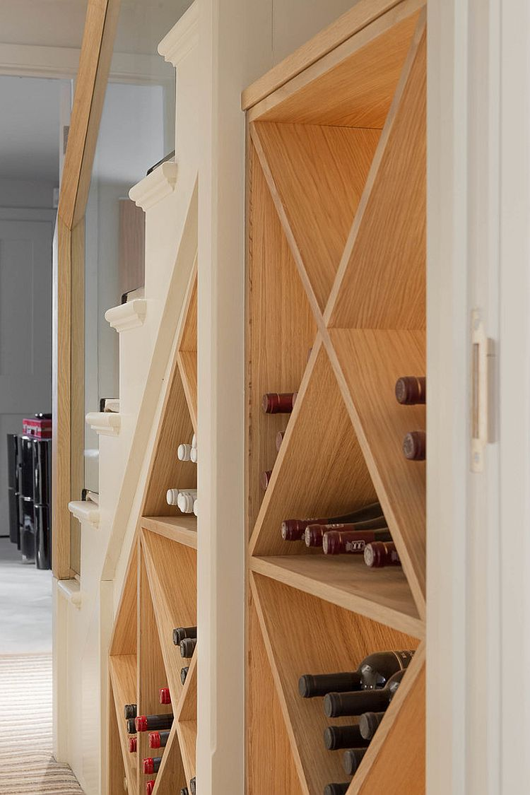 Simple wine storage idea for the small space under the modern staircase [Design: Nash Baker Architects]