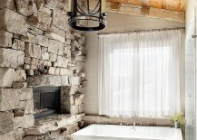 Ski lodge inspired rustic bathroom with a stone wall and sheer curtains 217x155 30 Exquisite and Inspired Bathrooms with Stone Walls