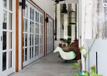 Sliding and folding doors replace walls to create a more cheerful ambiance indoors