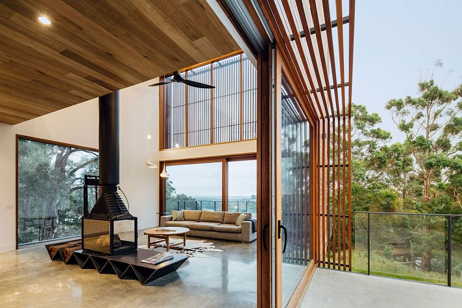 Sliding glass doors connects the living area with the small deck outside