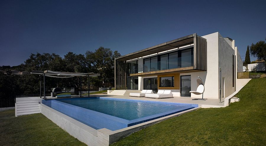 Sloped landscape reveals the gradual levels of the classy, modern villa