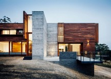 Sloped site of the Dawes Road House defines its overall silhouette 217x155 Spotted Gum Cladding and Concrete Envelope Nifty Aussie Home
