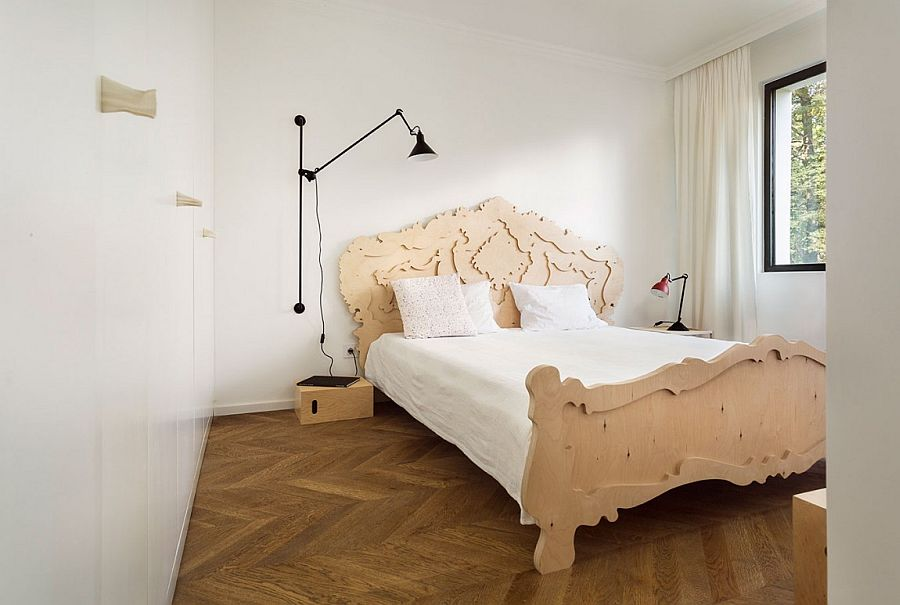 Small bedroom with bespoke plywood baroque bed