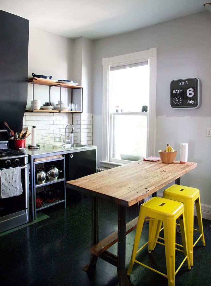 ... Small black and white kitchen with a pop of yellow