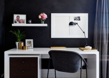 Small home workspace with a dark backdrop and sleek desk in white