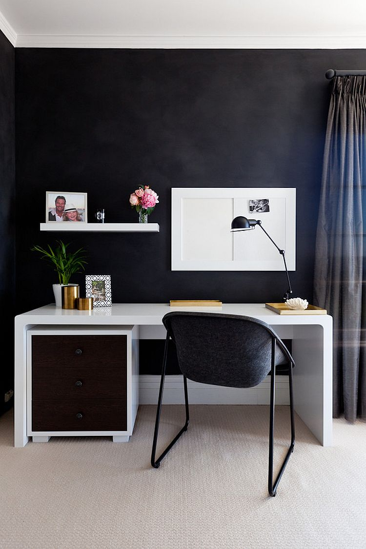 Small home workspace with a dark backdrop and sleek desk in white [Design: HC Interiors]