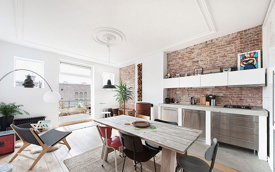 Small kitchen and dining area with exposed brick walls