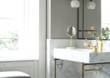 Small petal-like pendant light above a marble sink