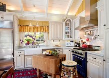 Small-shabby-chic-kitchen-with-an-innovative-butcher-block-island-217x155