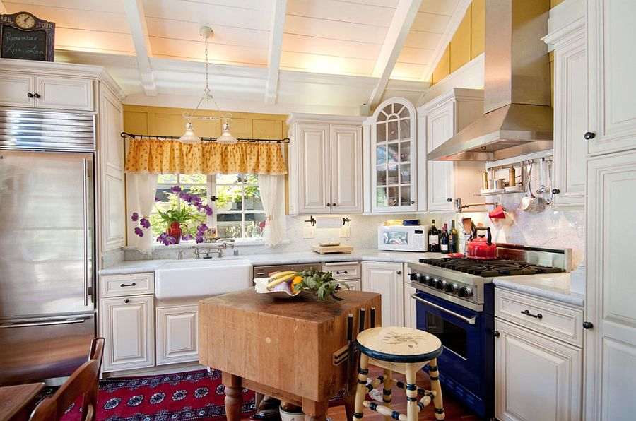 Small shabby chic kitchen with an innovative butcher block island [Design: Debra Campbell Design]