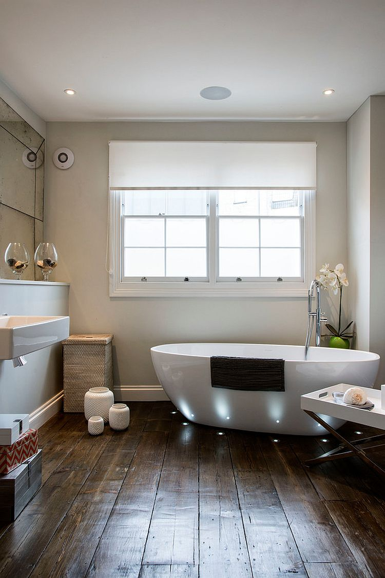 Smart lighting highlights the bathtub while giving the bathroom a spa-styled ambiance [Design: My Interior Stylist / Photo: Carole Poirot]